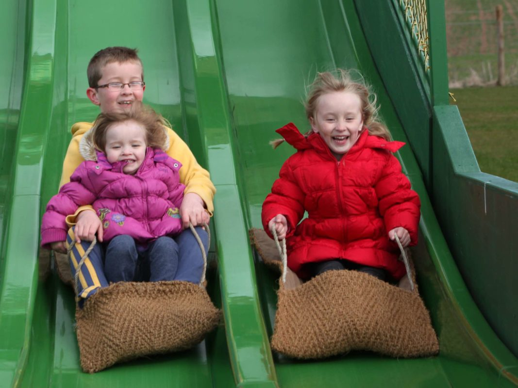 Kids on the Astra Slide laughing